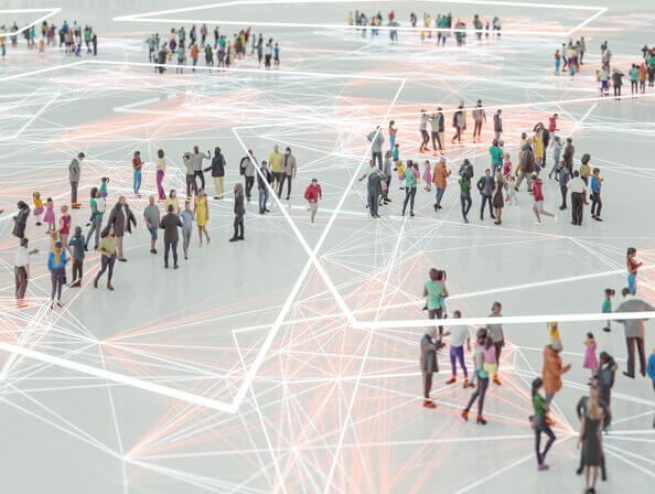 An aerial image of many people networking in groups, connected by a pattern of abstract lines.